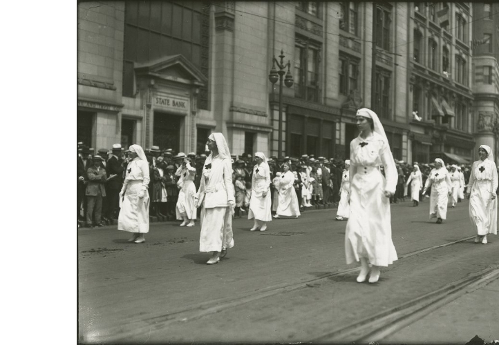 Women and Dress; Women Dressed in Red Cross Uniform in Parade