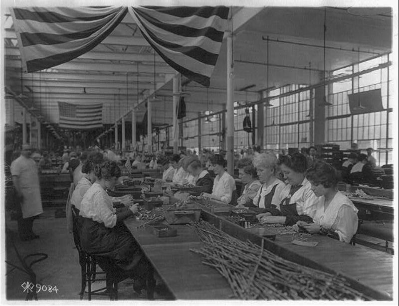 Women Inspecting Pistols