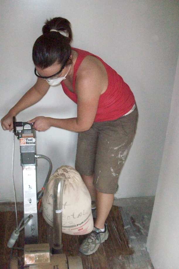 Sarah with the floor sander